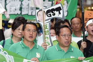 Albert Ho (front right) protesting against the introduction of the GST in Hong Kong