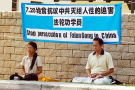 Ng Chye Huay and Erh Boon Tiong outside the Chinese Embassy on 20 July 2006 in a protest.