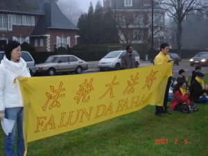 M Ravi (background) with Falungong members outside the Singapore Embassy in Brussels