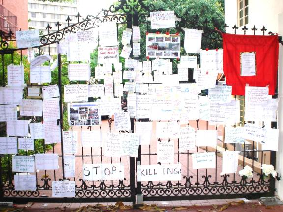The embassy gate plastered with angry messages