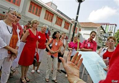 Expatriate women wearing red to protest in Singapore. (AP Photo/Wong Maye-E)